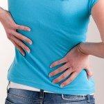 Woman suffering from Bulging Disc Disease